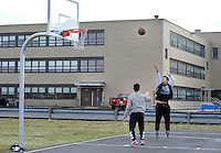 SEGAN13P<br /> From left, international students Barry Li and Johnny Zhang play basketball near the monastery where they are staying at Conwell-Egan Catholic High School Friday March 4, 2016 in Fairless Hills, Pennsylvania. (William Thomas Cain/For The Inquirer)