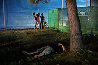 BENICÀSSIM, SPAIN - An English tourist lies passed out in the grass while a group of girls take turns urniating in a corner of the festival site. ..Described by some as a Mediterranean Glastonbury, the Festival Internacional de Benicàssim (FIB) is the largest music festival outside the UK to target British visitors. In 2010, seven of the eight main headline slots were filled by English bands...A small coastal town of 13,000 inhabitants, Benicàssim hosted some 200,000 visitors in 2009, with 40% of those believed to be coming from the UK. In 2010, attendances fell to 127,000 visitors but the percentage of UK visitors is believed to have risen.