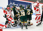 Jill Cardella (BU - 22) and Jenelle Kohanchuk (BU - 19) celebrate Cardella's goal which tied the game at 2 midway through the third period. - The Boston University Terriers tied the visiting University of Vermont Catamounts 2-2 on Saturday, November 13, 2010, at Walter Brown Arena in Boston, Massachusetts.