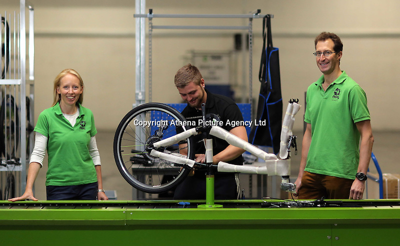 Pictured: Owners Shelley (L) and Jerry Lawson (R) with Jack Appleby (C) on the assembly line Monday 15 August 2016<br />Re: Frog Bikes in Mamhilad Estate Park in Pontypool, Wales, UK
