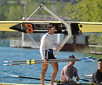 Banyoles, SPAIN, GRE LM1X, , Vasilieios POLYMEROS,  carrying his single scull   FISA World Cup Rd 1. Lake Banyoles  Thursday,  28/05/2009   [Mandatory Credit. Peter Spurrier/Intersport Images]