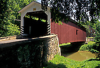 AJ4283, covered bridge, Lancaster County, Strasburg, Amish Country, Pennsylvania, Red wooden covered bridge in scenic Pennsylvania Dutch Country in Lancaster County in the state of Pennsylvania.