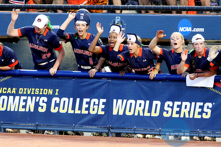 06 JUNE 2016: The Auburn University bench puts on their rally caps for the final inning against University of Oklahoma during the Division I Women's Softball Championship held at ASA Hall of Fame Stadium in Oklahoma City, OK.  University of Oklahoma defeated Auburn University in Game 1 by the final score of 3-2. Shane Bevel/NCAA Photos