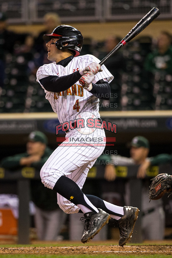 Kevin Smith (4) of the Maryland Terrapins bats during a 2015 Big Ten Conference Tournament game between the Maryland Terrapins and Michigan State Spartans at Target Field on May 20, 2015 in Minneapolis, Minnesota. (Brace Hemmelgarn/Four Seam Images)