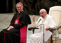 Papa Francesco, affiancato da Monsignor Georg Gaenswein, tiene l'udienza generale del mercoledi' in aula Paolo VI, Citta' del Vaticano,7 gennaio 2015.<br /> Pope Francis, flanked by Monsignor Georg Gaenswein, attends his weekly general audience in the Paul VI hall at the Vatican, 7 January 2015.<br /> UPDATE IMAGES PRESS/Isabella Bonotto<br /> <br /> STRICTLY ONLY FOR EDITORIAL USE