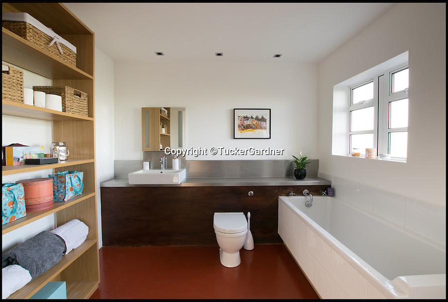BNPS.co.uk (01202 558833)<br /> Pic: TuckerGardner/BNPS<br /> <br /> One of the bathrooms.<br /> <br /> Potential buyers are scrambling to view a unique RAF control tower that has appeared on the property radar near Saffron Walden in Essex.<br /> <br /> A Second World War tower has been transformed into a stylish family home and is now on the market for &pound;775,000.<br /> <br /> Little Walden airfield in Essex was opened in 1944 and the base was home to American Mustang fighters and B17 Flying Fortresses throughout the war.<br /> <br /> It is now a four-bedroom home with a wrap-around balcony and access to the rooftop to make the most of the panoramic views of the surrounding open countryside.<br /> <br /> Although in its secluded rural location the only flypast your likely to see nowadays is of the feathered variety.
