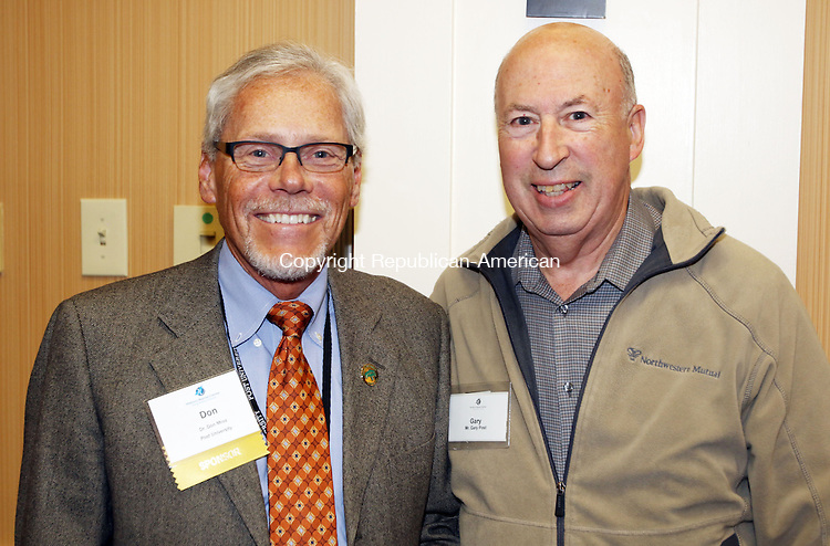 WATERBURY CT. 20 November 2015-112015SV06-From left, Don Mroz, president of Post University, and Gary Post of Southington attend A Book Launch Celebration for the release of &quot;Mac Baldrige: The Cowboy in Ronald Reagan's Cabinet,&quot; by Black and Cooper in Waterbury Friday. The event was co-sponsored by the Post University Malcolm Baldrige School of Business and the Waterbury Chamber.<br /> Steven Valenti Republican-American