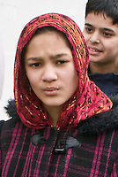 St Patricks Day parade High Street Digbeth.Close up of young asian girl watching Parade