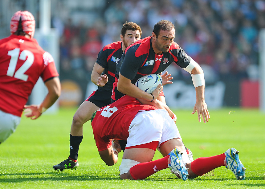 Georgia's Mamuka Gorgodze (c) is tackled by Tonga's Sione Kalamafoni<br /> <br /> Photographer Craig Thomas/CameraSport<br /> <br /> Rugby Union - 2015 Rugby World Cup - 12;00  Georgia v Tonga - Saturday 19th September 2015 - Kingsholm - Gloucester <br /> <br /> &copy; CameraSport - 43 Linden Ave. Countesthorpe. Leicester. England. LE8 5PG - Tel: +44 (0) 116 277 4147 - admin@camerasport.com - www.camerasport.com