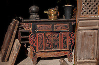 An open shop door reveals traditional cabinet and pitcher in Shuhe ancient town near Lijiang,Yunnan province.