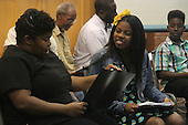 5947 &ndash; Ashley Mister and Makayla Purvis as mother and daughter, Yolanda and Casey Washington.<br /> <br /> The Hyde Park Community Players produced a stage reading of &ldquo;Raising the Roof&rdquo;, a play written by Vanessa Ellis and Jennifer Mubarak. The reading was held at Augustana Lutheran Church located at 55th and Woodlawn.<br /> <br /> Please 'Like' &quot;Spencer Bibbs Photography&quot; on Facebook.<br /> <br /> All rights to this photo are owned by Spencer Bibbs of Spencer Bibbs Photography and may only be used in any way shape or form, whole or in part with written permission by the owner of the photo, Spencer Bibbs.<br /> <br /> For all of your photography needs, please contact Spencer Bibbs at 773-895-4744. I can also be reached in the following ways:<br /> <br /> Website &ndash; www.spbdigitalconcepts.photoshelter.com<br /> <br /> Text - Text &ldquo;Spencer Bibbs&rdquo; to 72727<br /> <br /> Email &ndash; spencerbibbsphotography@yahoo.com