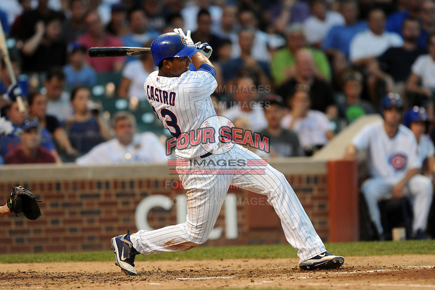 Chicago Cubs shortstop Starlin Castro #13 swings at a pitch during a game against the Miami Marlins at Wrigley Field on July 17, 2012 in Chicago, Illinois. The Marlins defeated the Cubs 9-5. (Tony Farlow/Four Seam Images).