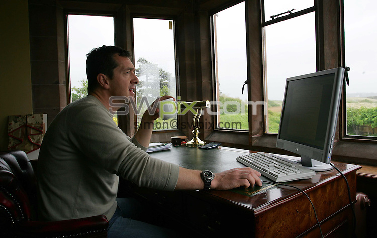Pix by BEN DUFFY/SWpix.com......Cycling.....Chris Boardman......22/05/06..Picture Copyright >> Simon Wilkinson >> 07811267706..Cycling star, Chris Boardman pictured with the Royal Liverpool golf club course in the background, which he can see from his house in Hoylake on the Wirral
