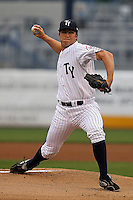 April 10, 2010: Pitcher Adam Warren of the Tampa Yankees delivers a pitch during a game at George M Steinbrenner Field in Tampa, FL. Tampa is the Florida State League affiliate of the New York Yankees. Photo By Mark LoMoglio/Four Seam Images