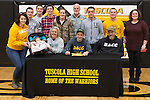 February 3, 2017- Tuscola, IL- Tuscola Warrior Cross Country's Trent Ponder signs his letter of intent to compete for the Danville Area Community College Jaguars surrounded by family, friends, coaches, and teachers. [Photo: Douglas Cottle]