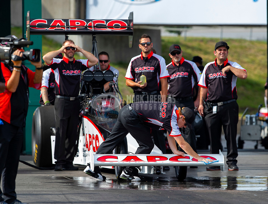 May 18, 2018; Topeka, KS, USA; Crew members for NHRA top fuel driver Steve Torrence during qualifying for the Heartland Nationals at Heartland Motorsports Park. Mandatory Credit: Mark J. Rebilas-USA TODAY Sports