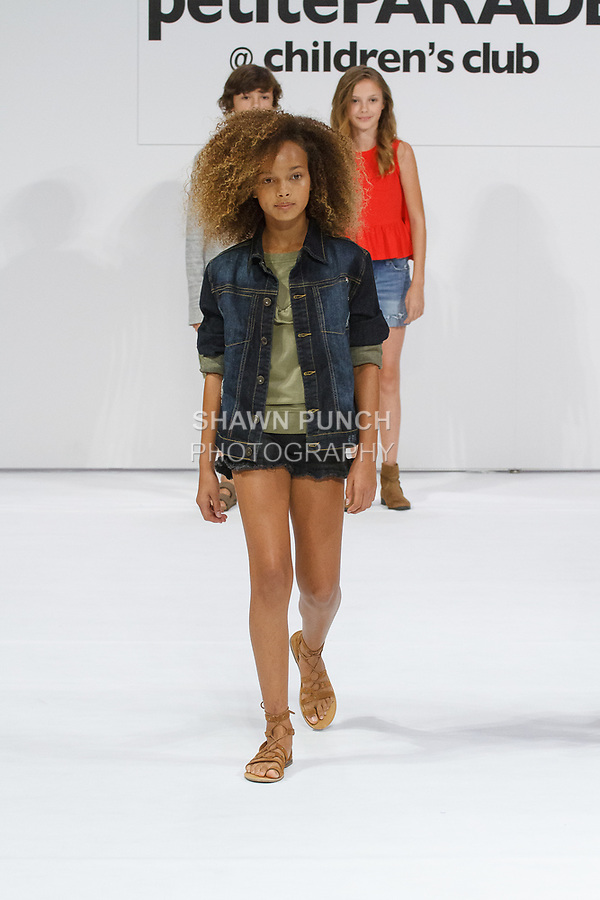 Child model walks runway in an outfit from the collection, during petitePARADE Spring Summer 2018 with Children's Club, at the Javits Center on August 6, 2017. Child models pose on runways in outfits from the Hudson Kids collection, during petitePARADE Spring Summer 2018 with Children's Club, at the Javits Center on August 6, 2017.
