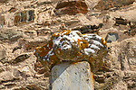 Close-up of ancient marble sculpture of Saint Mary, Santa Maria, aged with orange shield lichen resting one pedestal at the village of Terena, Alentejo Central, Portugal, Southern Europe