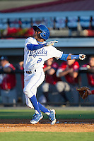 D.J. Burt (2) of the Burlington Royals follows through on his swing against the Danville Braves at Burlington Athletic Park on July 5, 2014 in Burlington, North Carolina.  The Royals defeated the Braves 5-4.  (Brian Westerholt/Four Seam Images)