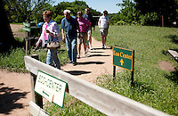 A group of tourists take a walk near the eco center at Fossil Rim Wildlife Center in Glen Rose, Texas, April 25, 2010. Fossil Rim Wildlife Center Park offers 1,700 acres with 1,100 animals which roam freely in large pastures.. .PHOTOS/ MATT NAGER