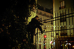 [English]  Salman, a 14-year old refugee, is climbing the fence of the Villemin park to spend the night there. This public park is located between &quot;Gare de l'Est&quot; train station and Saint-Martin canal, eastern Paris.<br />