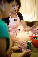 Personal canning coach Kelly Ingram (cq, back) discusses proper canning techniques to Wall Street Journal reporter Ana Campoy (cq) during a pickling and canning class in Dallas, Texas, USA, Saturday, Sept. 12, 2009. Growing produce or buying locally grown vegetables and canning at home is a fun and healthy way to keep grocery costs down...CREDIT: Matt Nager for The Wall Street Journal