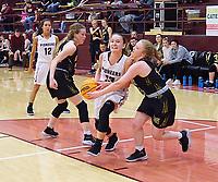 Westside Eagle Observer/RANDY MOLL<br /> Gentry senior Ariel Nix attempts to move the ball past West Fork defenders during play at Gentry High School on Dec. 3.
