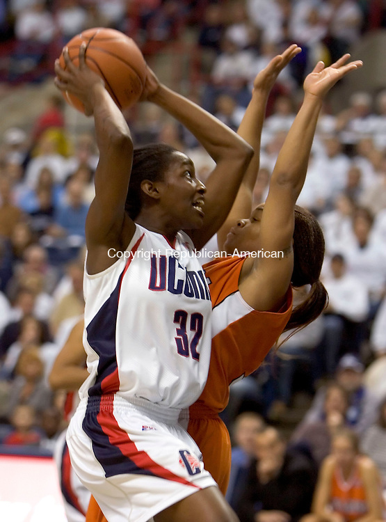 STORRS, CT--13 JANUARY 2007--011307JS03-UConn's Kalana Greene gets fouled by Syracuse Cintia Johnson during their game Saturday at Gampel Pavilion in Storrs. <br /> Jim Shannon / Republican-American