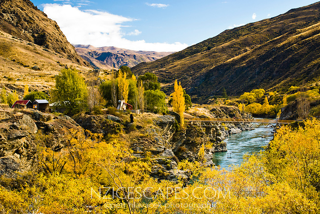 Kawarau River with historical goldmining village to the left - Queenstown, Central Otago, New Zealand