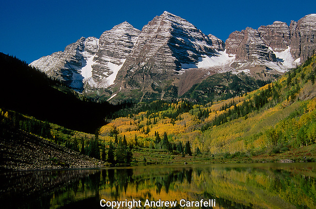 The iconic 14,000 ft Maroon Bells near Aspen, CO display all their fall glory.