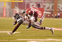 NWA Democrat-Gazette/MICHAEL WOODS • Mississippi State defender Taveze Calhoun tackles Arkansas tight end Jeremy Sprinkle as he tries to make a catch in the 3rd quarter of Saturday nights game at Razorback Stadium November 21, 2015.