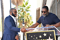 LOS ANGELES, CA. October 01, 2019: Tyler Perry & Idris Elba at the Hollywood Walk of Fame Star Ceremony honoring Tyler Perry.<br /> Pictures: Paul Smith/Featureflash