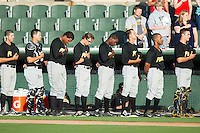 The West Virginia Power stand for the National Anthem prior to the game against the Kannapolis Intimidators at CMC-Northeast Stadium on May 1, 2014 in Kannapolis, North Carolina.  The Power defeated the Intimidators 5-4.  (Brian Westerholt/Four Seam Images)