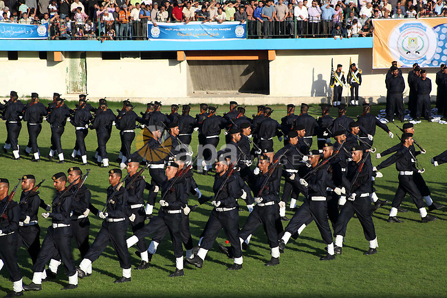 Graduating police officers march during a ceremony at the police academy in Gaza City on June 13, 2012, making them the first batch of officers to graduate after four years of training under the Hamas leadership. Hamas has governed the Gaza Strip since June 2007, after it won a majority of seats in the Palestinian Parliament in the January 2006 Palestinian parliamentary elections, and then defeated the Fatah political organization in a series of clashes. Photo by Ashraf Amra