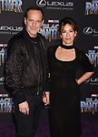 HOLLYWOOD, CA - JANUARY 29: Actors Clark Gregg (L) and Jennifer Grey attend the premiere of Disney and Marvel's 'Black Panther' at  the Dolby Theater on January 28, 2018 in Hollywood, California.