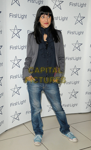 MANINDER VIRK.First Light Awards at Odeon Leicster Square, London, England. .March 15th, 2011.full length jeans denim grey gray jacket black shirt scarf converse trainers sneakers shoes hands in pockets .CAP/CAN.©Can Nguyen/Capital Pictures.
