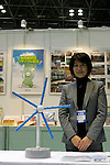 DECEMBER 10, 2009 - TOKYO - JAPAN: Mecaro Director Minoru Yonedo poses with the Spiral Magnus for a demonstration at the Eco-Product 2009 in Tokyo Big Sight. Some 700 exhibitors introduce their consumer goods, industrial materials, energies, finance and various services during three days. New environmental technologies and services that aim to change conventional wisdom, and new business models that aim to solve specific problems, including company coalitions and regional cooperation are displaying. In addition, 20,000 students in the Kanto Region as a school activity, and families can experience the low-carbon lifestyle of the near-future. 180,000 visitors are expected to attend (photo by Laurent Benchana/Nippon News).