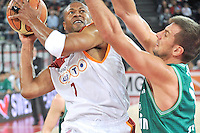 Charles Smith (left) of Virtus Lottomatica Roma determined to score against Sandro Nicevic of Benetton Treviso during a National Championship basketball match in Rome, Italy on November 13, 2010.
