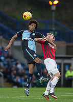 Sido Jombati of Wycombe Wanderers wins the ball in the air during the Sky Bet League 2 match between Wycombe Wanderers and Crawley Town at Adams Park, High Wycombe, England on 28 December 2015. Photo by Andy Rowland / PRiME Media Images