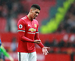 Chris Smalling of Manchester United shows frustration by punching his hand as he walks off during the premier league match at the Old Trafford Stadium, Manchester. Picture date 15th April 2018. Picture credit should read: Simon Bellis/Sportimage