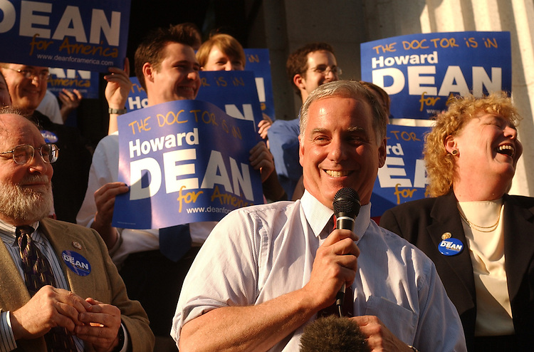 dean3/062403 - Presidential candidate Howard Dean, D-Vt., speaks at a rally at the Capitol City Brewery on Mass. Ave, NE., flanked by Reps. Neil Abercrombie, D-Haw., and Zoe Lofgren, D-Calif.