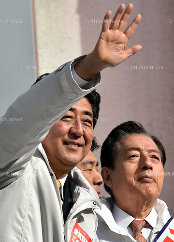 Decem ber 7, 2014, Tokyo, Japan - Japan's Prime Minister Shinzo Abe delivers his message to a huge throng of voters during his stumping stop in the capital's 12th precinct on Sunday, December 7, 2014. Transport Minister Akihiro Ota of Komeito, right, the ruling coalition ally of the Liberal Democratic Party is running from the precinct. Abe's LDP is expected to retain its dominance in the December 14 parliament's lower house election, according to latest polls. (Photo by Natsuki Sakai/AFLO) AYF -mis-