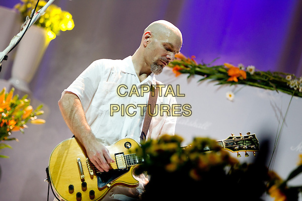 Faith No More.Faith No More in concert, Moscow, Russia..July 2nd, 2012.on stage live gig performance performing music white top half length profile guitar .CAP/PER/SB.©SB/PersonaStars/CapitalPictures