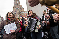 New York, USA 5 February 2017 - THIS IS WHAT DEMOCRACY SOUNDS LIKE Several hundred people gathered beneath the arch in Washington Square Park for a community sing along, playine folk songs to benefit the ACLU (American Civil Liberties Union) and NYCLU (New York Civil Liberties Union) in their lawsuits challenging president donald trump, human rights as well as civil rights issues. @ Stacy Walsh Rosenstock