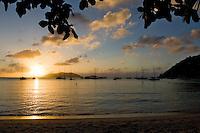Sunset over Jost Van Dyke from the beach at Cane Garden Bay, Tortola, British Virgin Islands