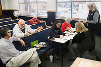 NWA Democrat-Gazette/CHARLIE KAIJO Mindy McAlindon, secretary for the Benton County Republican party, (from center left) and Mary Neal, Notary Public, help candidates fill out filing paperwork, Monday, November 4, 2019 during candidate filing at the Benton County Administration Building in Bentonville.