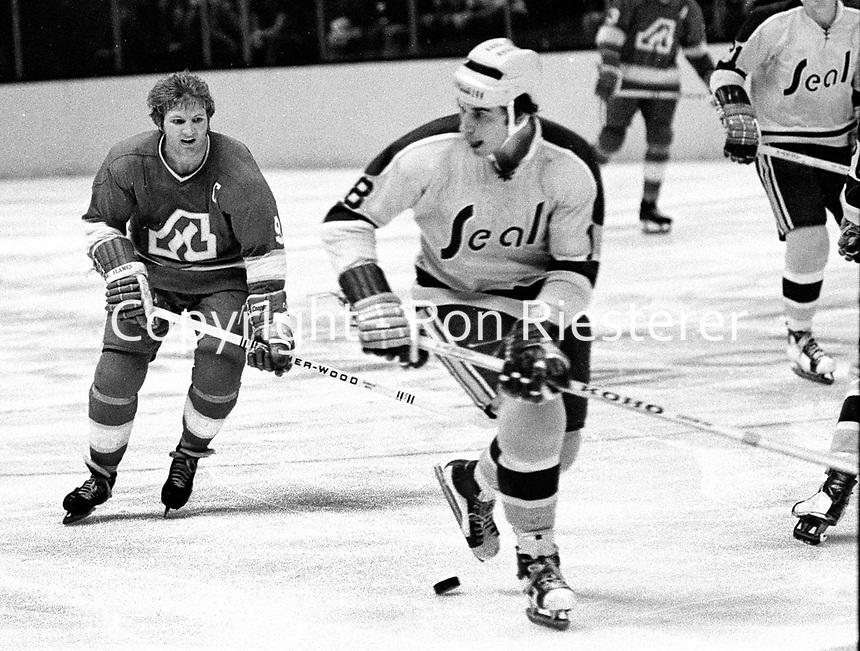 California Golden Seals vs Atlanta Flames action, Flames #9 Keith McCreary, and the Seals Gary Croteau. (1972 photo/Ron Riesterer)