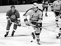 California Golden Seals vs Atlanta Flames action, Flames #9 Keith McCreary, and the Seals Gary Croteau. (1972 photo/Ron Riesterer)