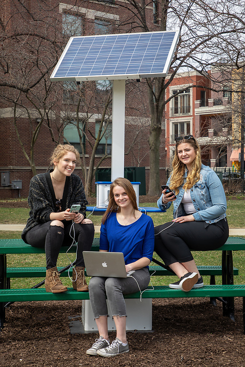 Left to right, Sydney Coyle, junior in environmental studies and peace justice and conflict studies, Katy Bozich, junior in public relations and advertising and political science, and Anna Pierce, junior in organizational communication and sociology, are members of DePaul's Student Government Association (SGA) and are working to have solar panels installed on the roofs of McGowan North and the 1150 West Fullerton buildings on the Lincoln Park Campus. (DePaul University/Jeff Carrion)