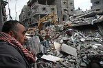 Palestinian firefighters work in the rubble of senior Hamas militant Nizar Rayan's house, who was killed Thursday in an Israeli airstrike with 4 of his wives and 10 of his children, in the Jebaliya refugee camp, northern Gaza Strip, Friday, Jan. 2, 2009. Israel showed no sign of slowing a blistering seven-day offensive against Hamas militants in Gaza, destroying homes of the group's leaders and bombing one of its mosques a day after a deadly strike on a prominent Hamas figure killed him and most of his family.  APAIMAGES PHOTO / Ashraf Amra